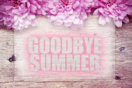 pink flowers on wooden with word Goodbye Summer
