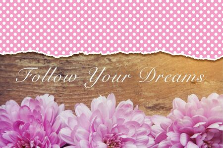 pink flowers on wooden with word Follow your dream