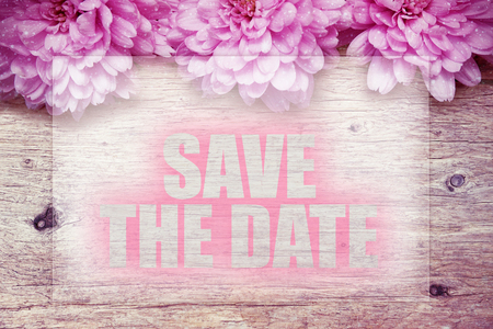 pink flowers on wooden with word Save the date Stock fotó