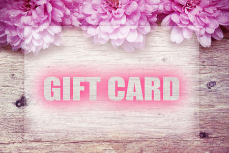 pink flowers on wooden with word GIFT CARD