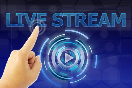 hand pointing LIVE STREAM word on blue digital background Stock Photo