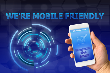 mobile app: Woman hand holding smartphone against digital blue background MOBILE FRIENDLY concept