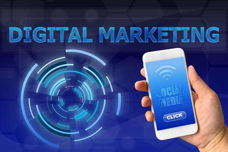 Woman hand holding smartphone against digital blue background DIGITAL MARKETING concept