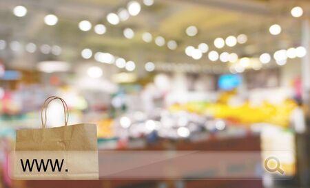 reusable: reusable paper shopping bag against blur bokeh of store background online shopping concept