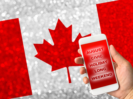 canada flag on bokeh background with word August Civic Holiday Long Weekend