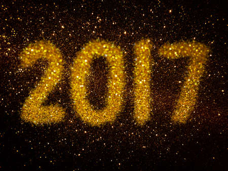 gold glitter abstract background with word 2017