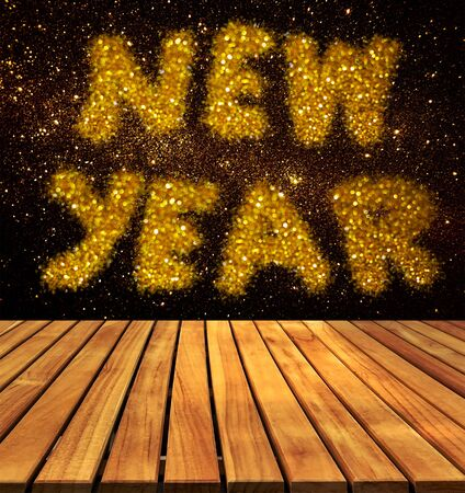 top year: old wood table top on wall with word new year on galaxy wall background