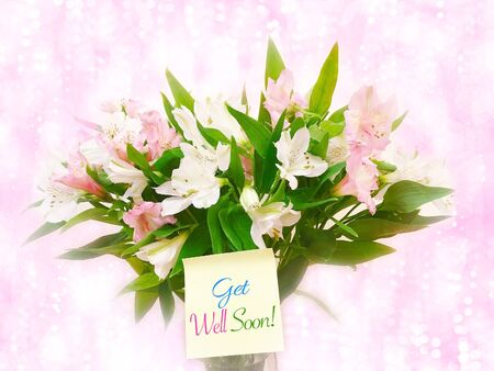 Bouquet of pink and white flowers on pink glitter bokeh background with word get well soon