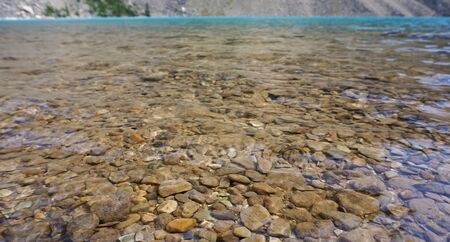 see through: Blue and clear lake see through rocks Stock Photo