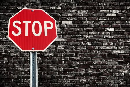 old sign: Stop sign on old grunge brick background Stock Photo