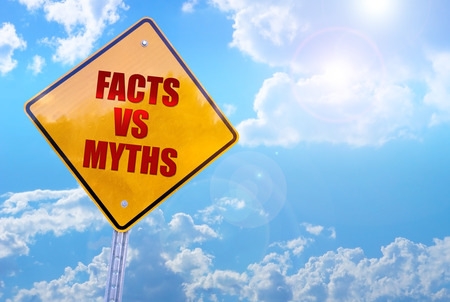facts vs myths word on yellow traffic sign blue sky background 版權商用圖片