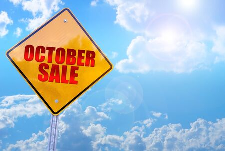 october sale word on yellow traffic sign blue sky background