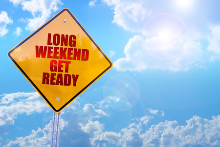 get ready: long weekend get ready word on yellow traffic sign blue sky background
