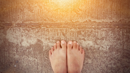 bare feet road background with sun ray effect Stock Photo