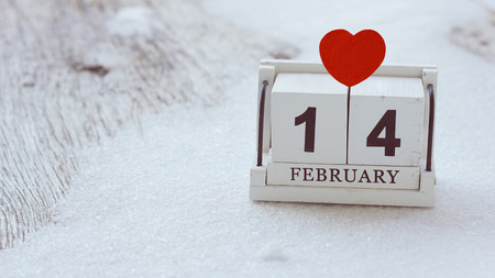 14 February wood calendar with red heart on top Valentine's Day card 免版税图像