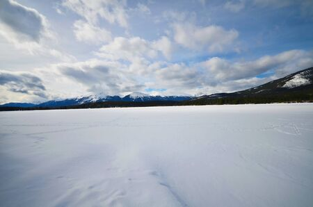 frozen lake and mountains covered with snow in National Park Stok Fotoğraf - 75280732