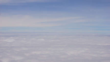 The sky above the clouds, defocused blur background