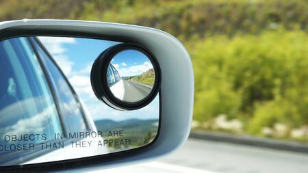 Side rear view mirror on a car Standard-Bild