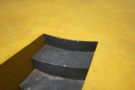 Public stair with yellow concrete floor. Stock fotó