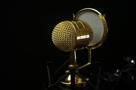Mic Condenser Gold. Isolated on black background. Selective Focus