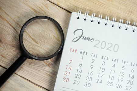 June 2020 Calender with magnifying glass. Selective focus.