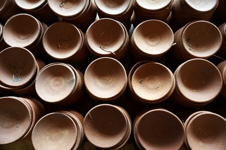 Earthenware, pottery that has not been fired to the point of vitrification and is thus slightly porous and coarser than stoneware and porcelain.