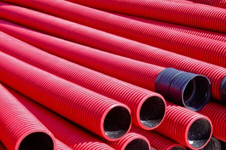A stockpile of flexible ducts to be used for protection of underground electric cable photo