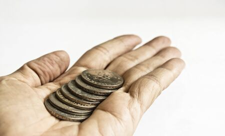 stretched out: A show of some coins in a stretched out hand