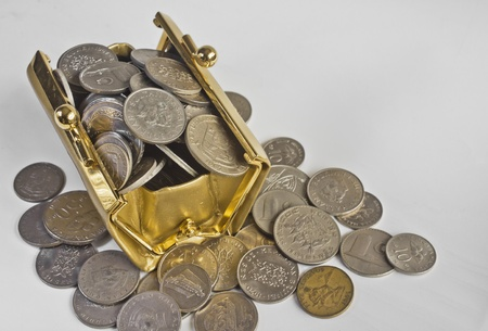 A golden colored bag filled with coins  photo