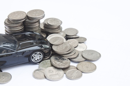Model car crashes into stack of money Stock Photo - 10508926