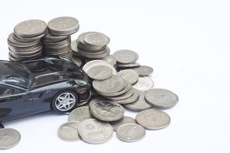 Model car crashes into stack of money Stock Photo - 10508926