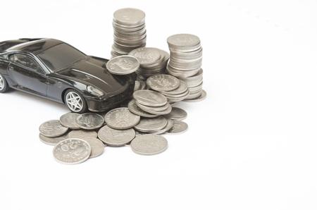 Model car crashes into stack of money Stock Photo - 10508925