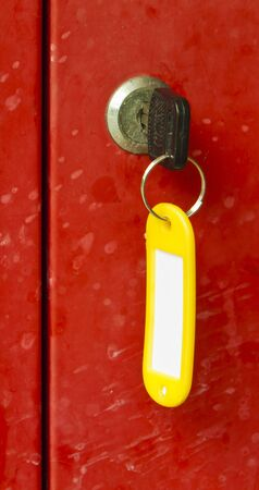 tagged: A red metal locker with tagged key attached. Stock Photo