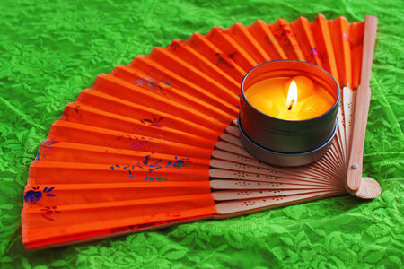 Hand fan and candle  photo