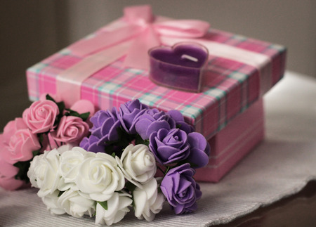 gist: Gift and roses Stock Photo
