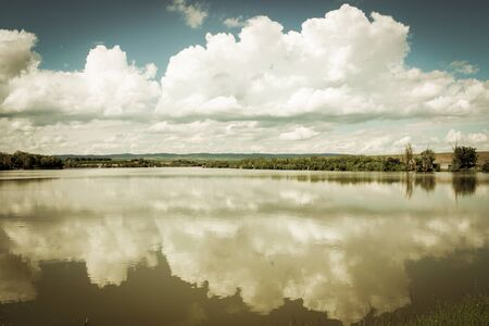 Reflection of clouds on Borkovac Lake in Ruma, Serbia
