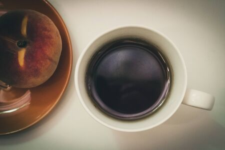 Cup of coffee and peach