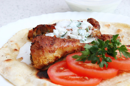 Tandoori chicken, flat bread roti and cucumber raita