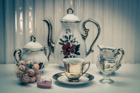 Vintage cup and kettle Banque d'images