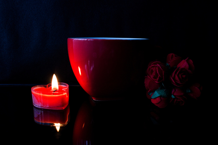 Red cup and candle