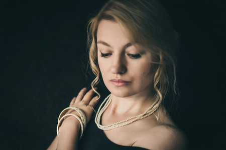Blonde with necklace and bangles