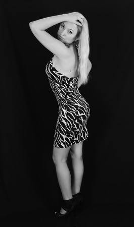Blonde in zebra pattern dress