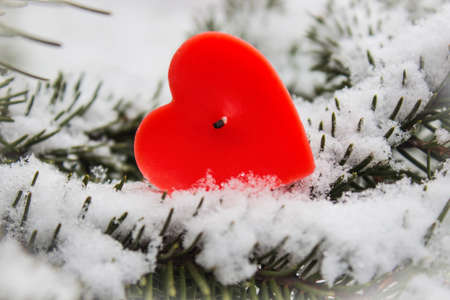 Heart candle and snow