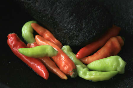 Mortar contains colorful chilies, ready to be pulverized and processed into chili sauce and other dishes.