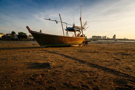 fishingboats: The fishing boat on the beach in sunset