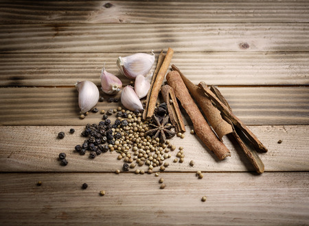 Herbs and spices stewed eggs on the wood background Stock Photo