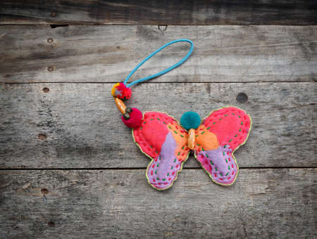 oldened: The butterfly  Craft of rag on the wood background