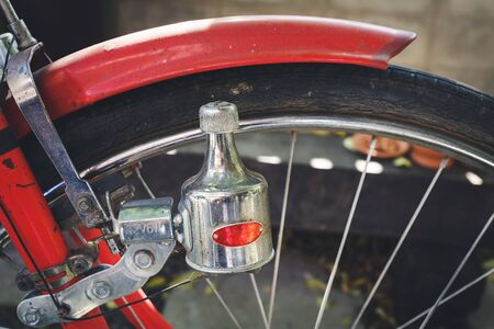 Dynamo red old bicycle and old bike tires background