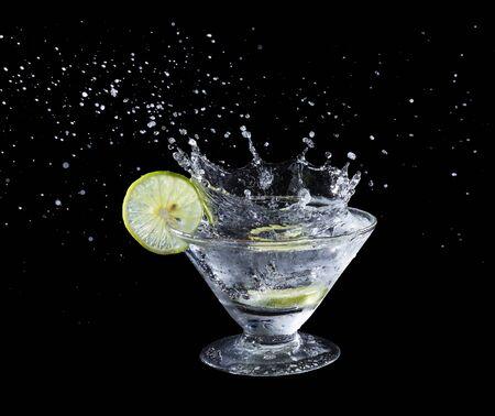 lime juice: Lime juice splash on black background Stock Photo