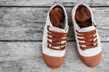 untied: The Boys shoes, Sneakers on wood background